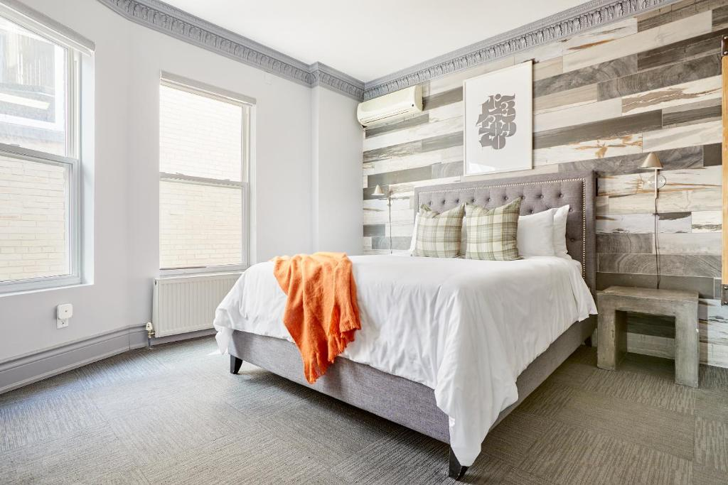 A bed or beds in a room at Sonder — The Wellesley