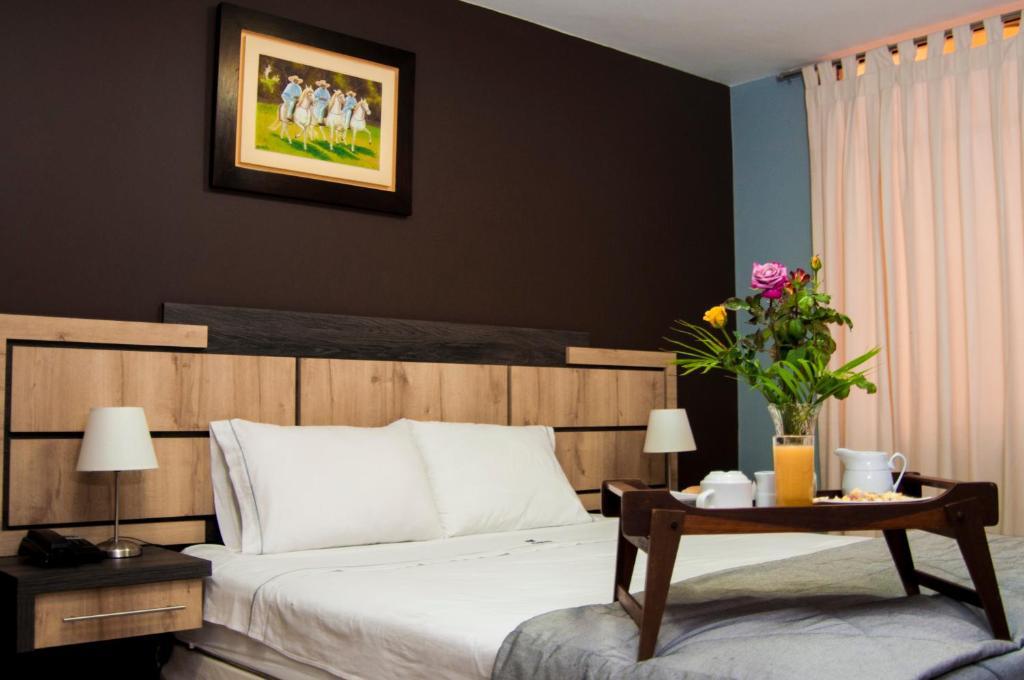 Postelja oz. postelje v sobi nastanitve Hotel Chimu