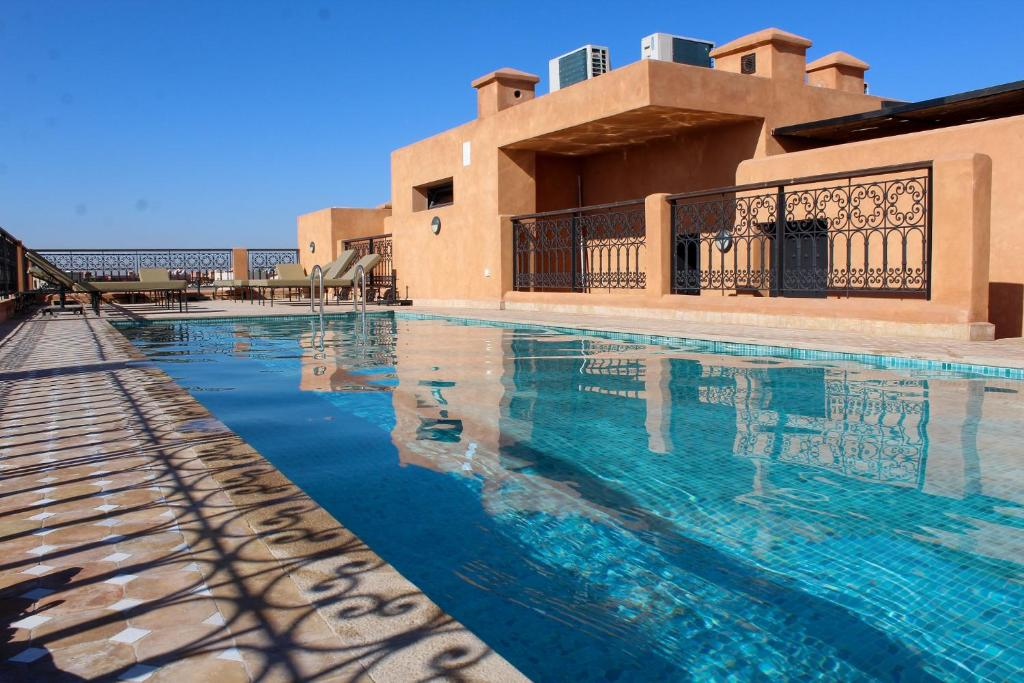 The swimming pool at or near SUBLIME APPARTEMENT AVEC PISCINE SUR LE TOIT