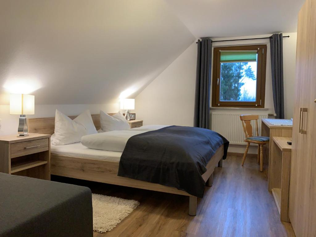A bed or beds in a room at Hohe Tanne