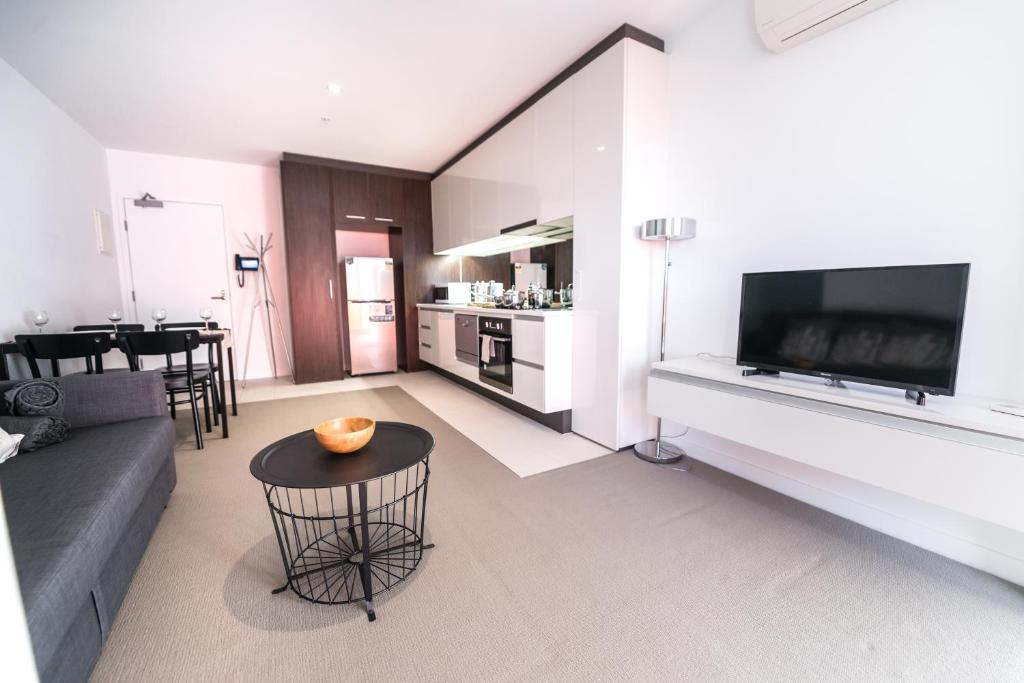 A television and/or entertainment center at Contempo CBD Suites with Pool, Gym + FREE WiFi