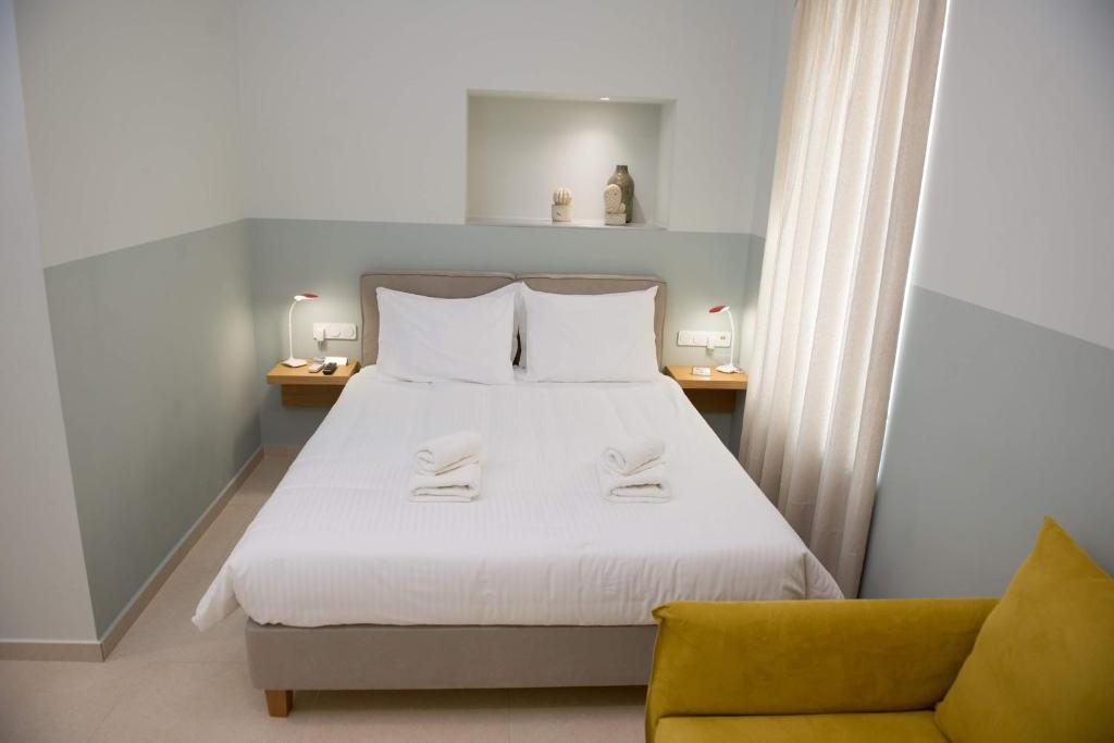 Ένα ή περισσότερα κρεβάτια σε δωμάτιο στο Stylish Studio Apartment - 1 House