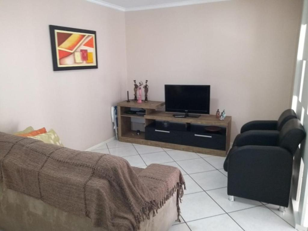 A television and/or entertainment centre at Apart Central Petit Vilage by MY HOME