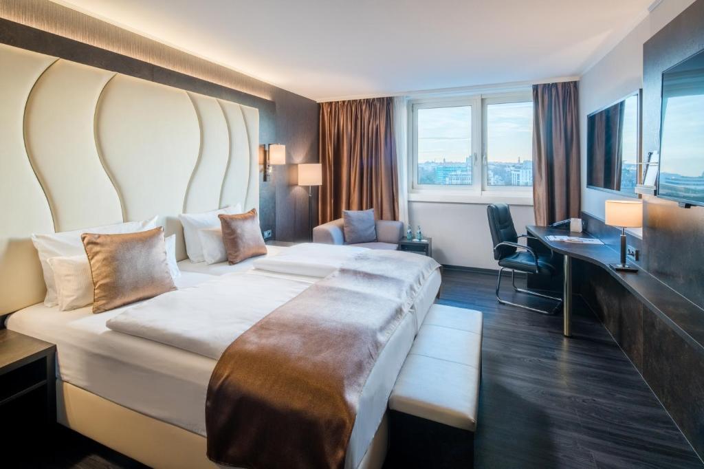 Ein Bett oder Betten in einem Zimmer der Unterkunft Best Western Plus Plaza Hotel Darmstadt