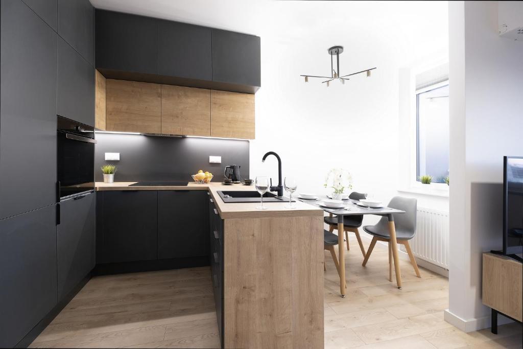 Kuchnia lub aneks kuchenny w obiekcie Blue Sky Apartments - City Center