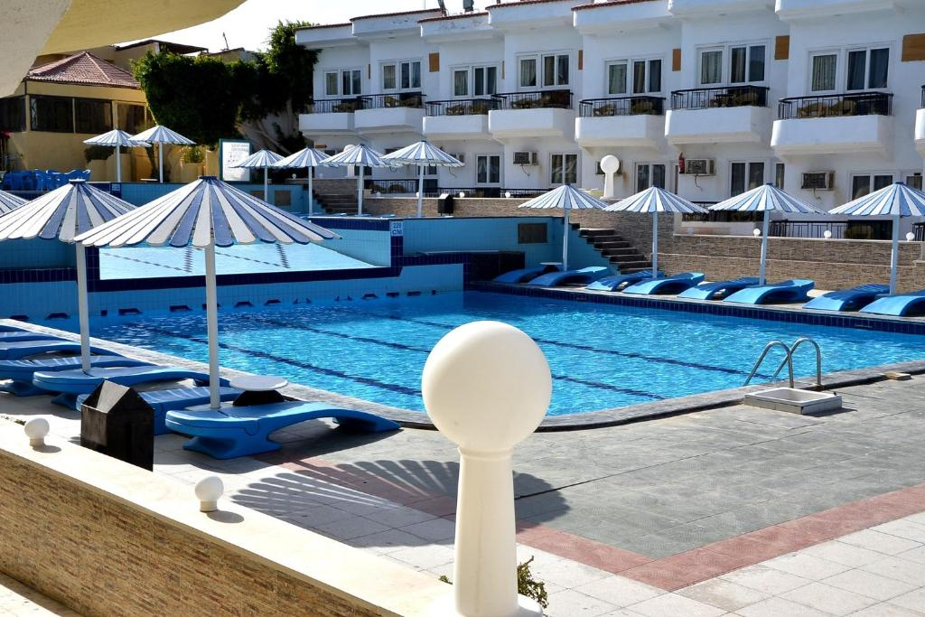 The swimming pool at or near Sand Beach Resort