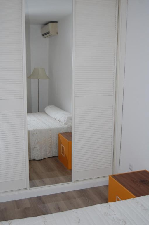 A bed or beds in a room at Bica House