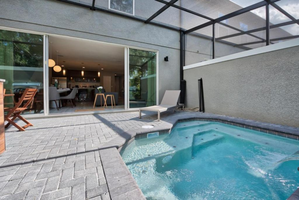 The swimming pool at or close to Near Disney World - Le Reve - Amazing Contemporary 4 Beds 3.5 Baths Townhome - 6 Miles To Disney