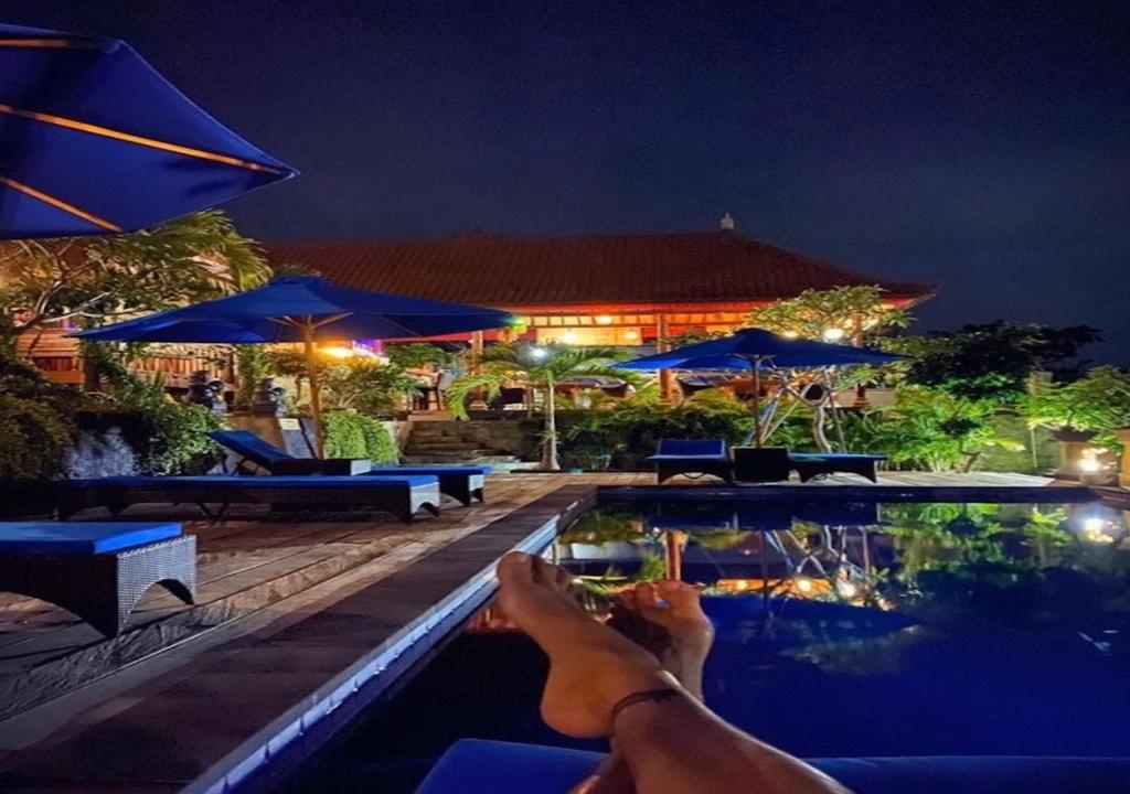 The swimming pool at or near Tatak Bunut villa