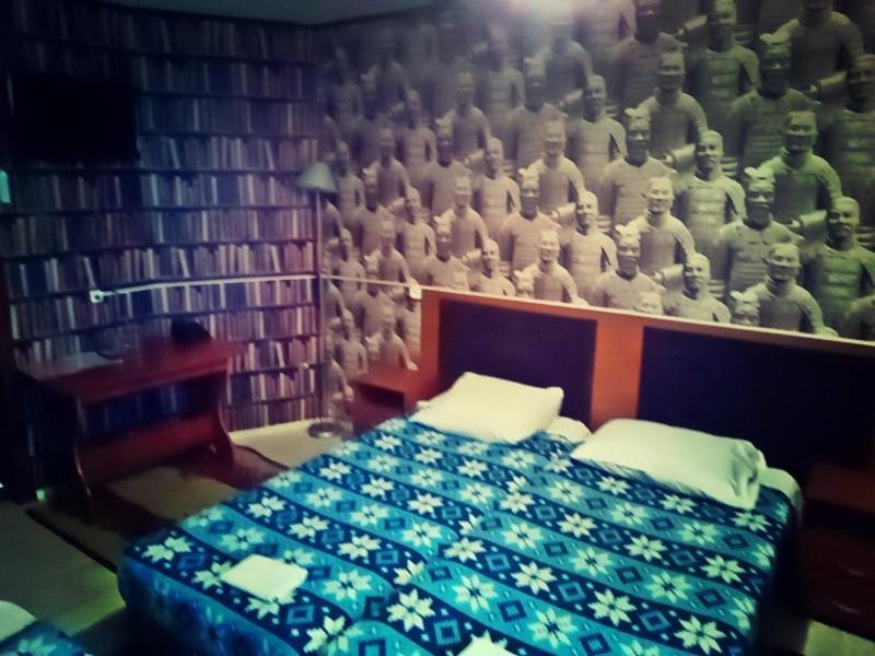 Кровать или кровати в номере Мини Отель Сак