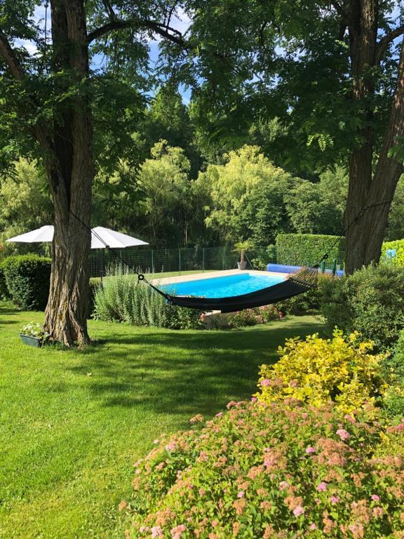 A garden outside LA FERME D'AIGUROLLES