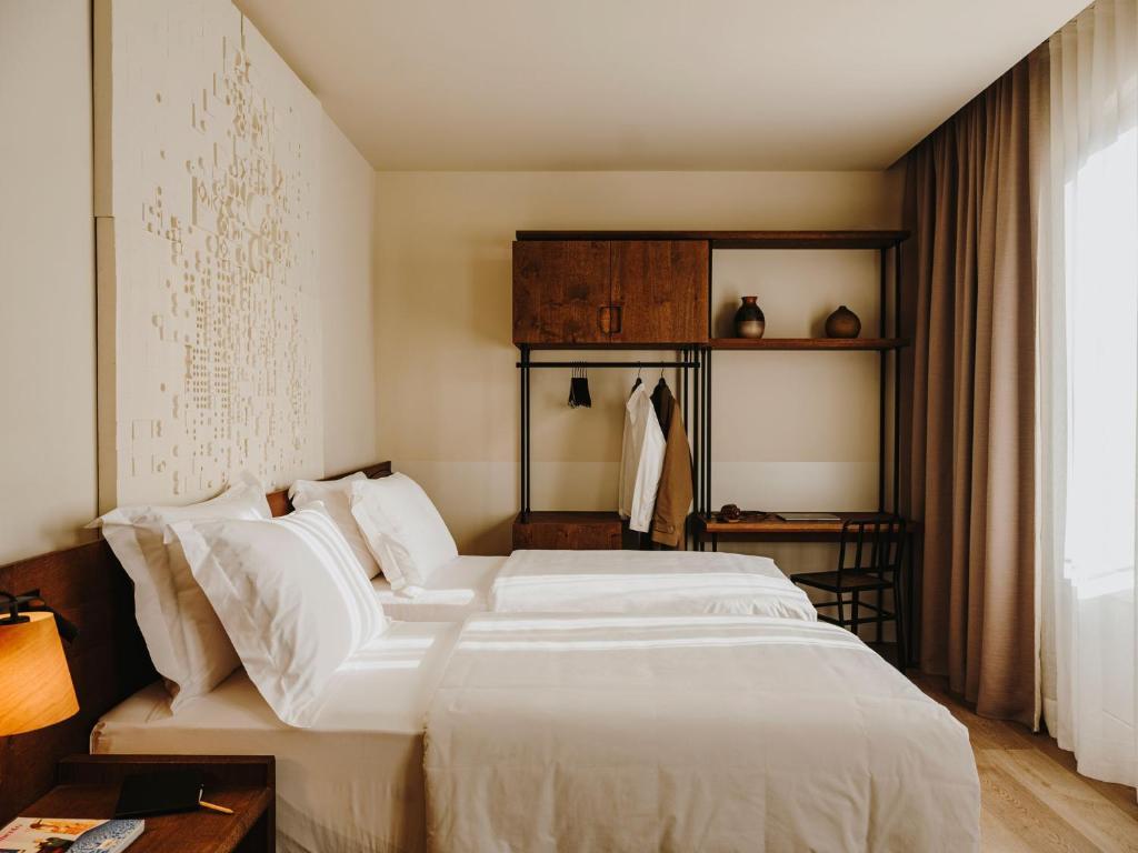 Cama o camas de una habitación en Hotel Casa Luz