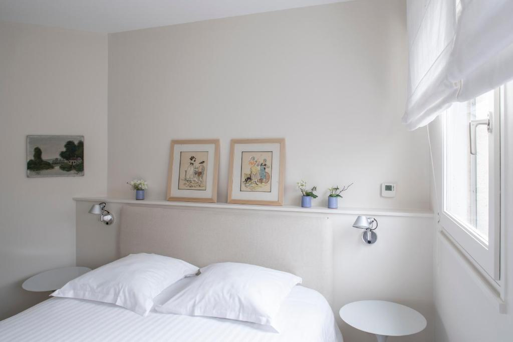A bed or beds in a room at Suite Si Calme