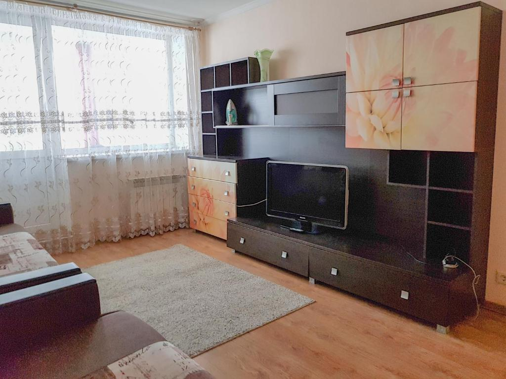 A television and/or entertainment center at Апартаменты Кристалл на пр.Победы 30А