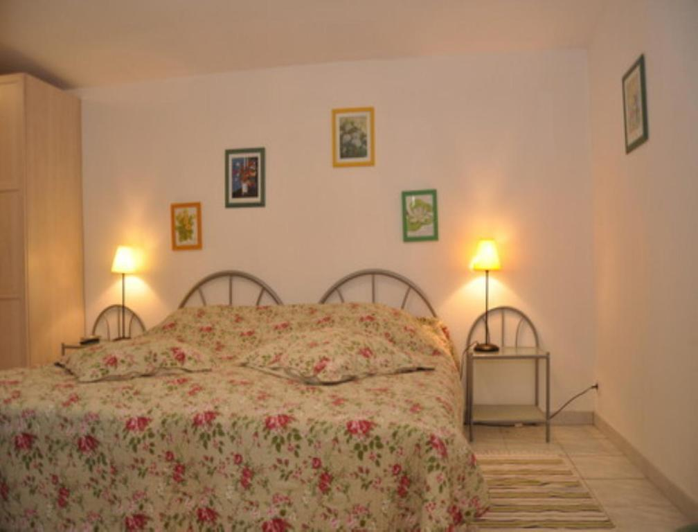 A bed or beds in a room at Chambres d'hotes Welcome