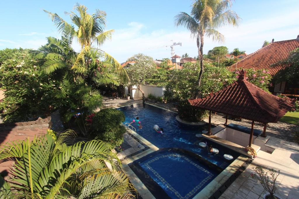 A view of the pool at Taman Agung Hotel or nearby