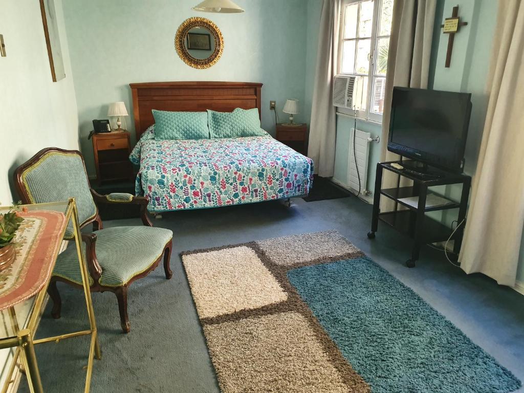 Cama ou camas em um quarto em Hotel Foresta
