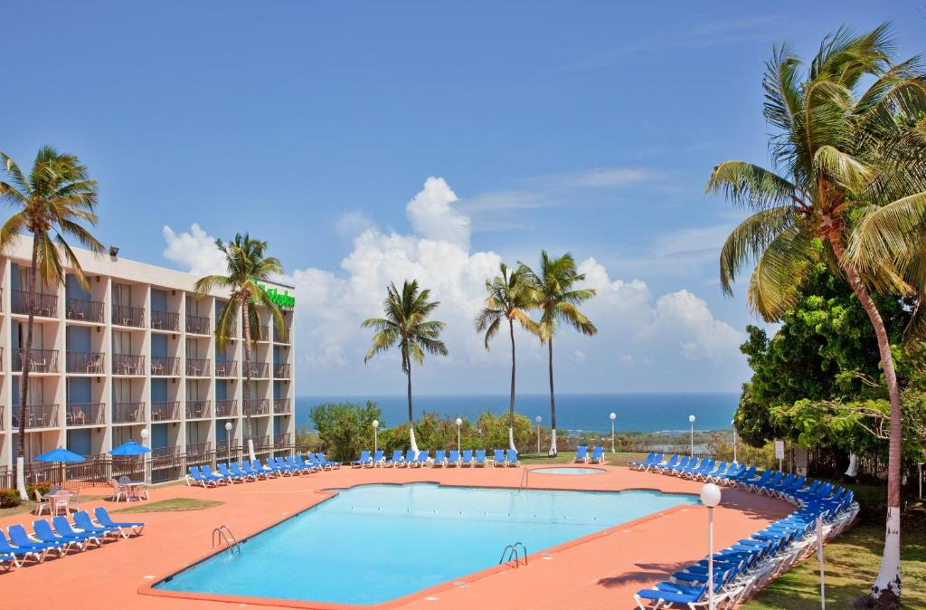 The swimming pool at or near Holiday Inn Ponce & El Tropical Casino, an IHG Hotel