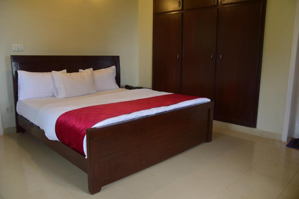 A bed or beds in a room at Youth Hostel Association