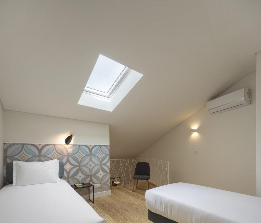 A bed or beds in a room at Lisbon Serviced Apartments - Santos