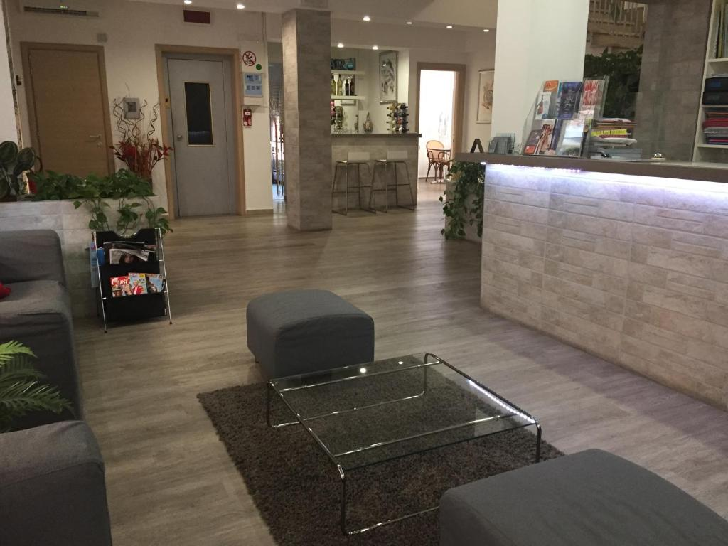 The lobby or reception area at Hotel Capitol