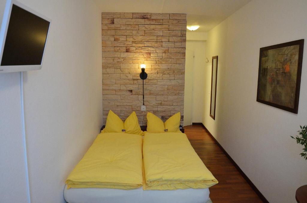 Ein Bett oder Betten in einem Zimmer der Unterkunft Zunfthaus zu Wirthen