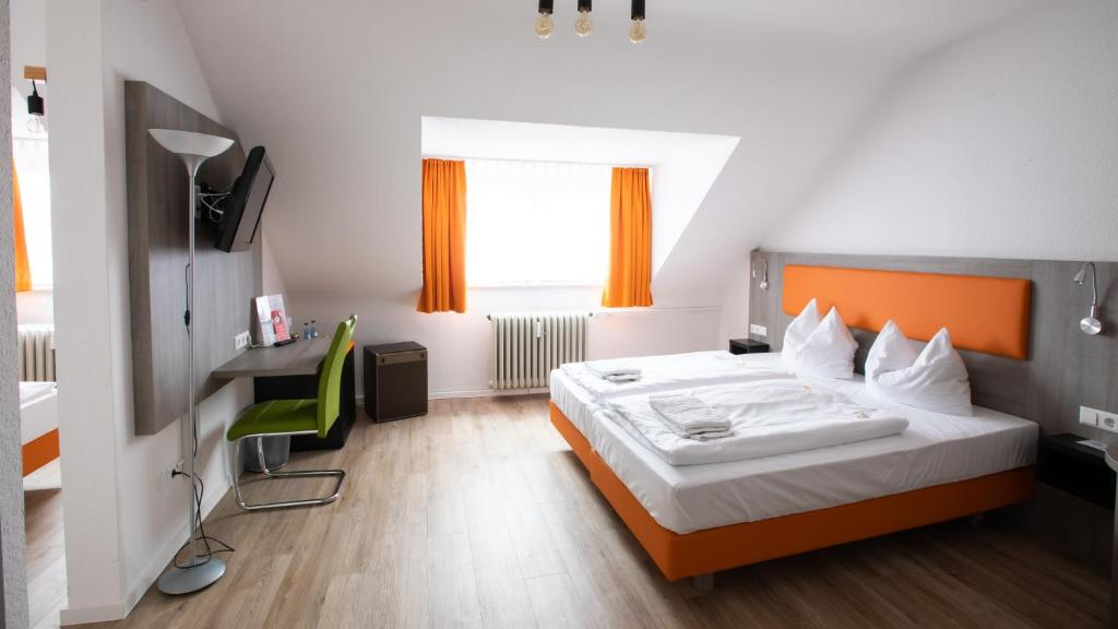 Кровать или кровати в номере Hotel Astoria