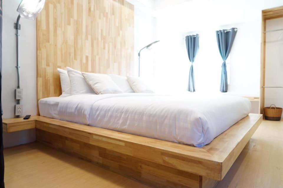 A bed or beds in a room at Sabai Nimman