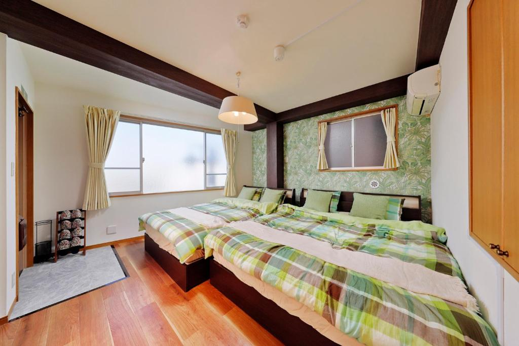 A bed or beds in a room at Terrace Terano#201