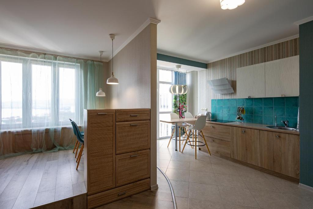 A kitchen or kitchenette at Apartment PiniCasa
