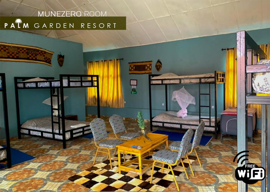 A bunk bed or bunk beds in a room at Palm garden Resort