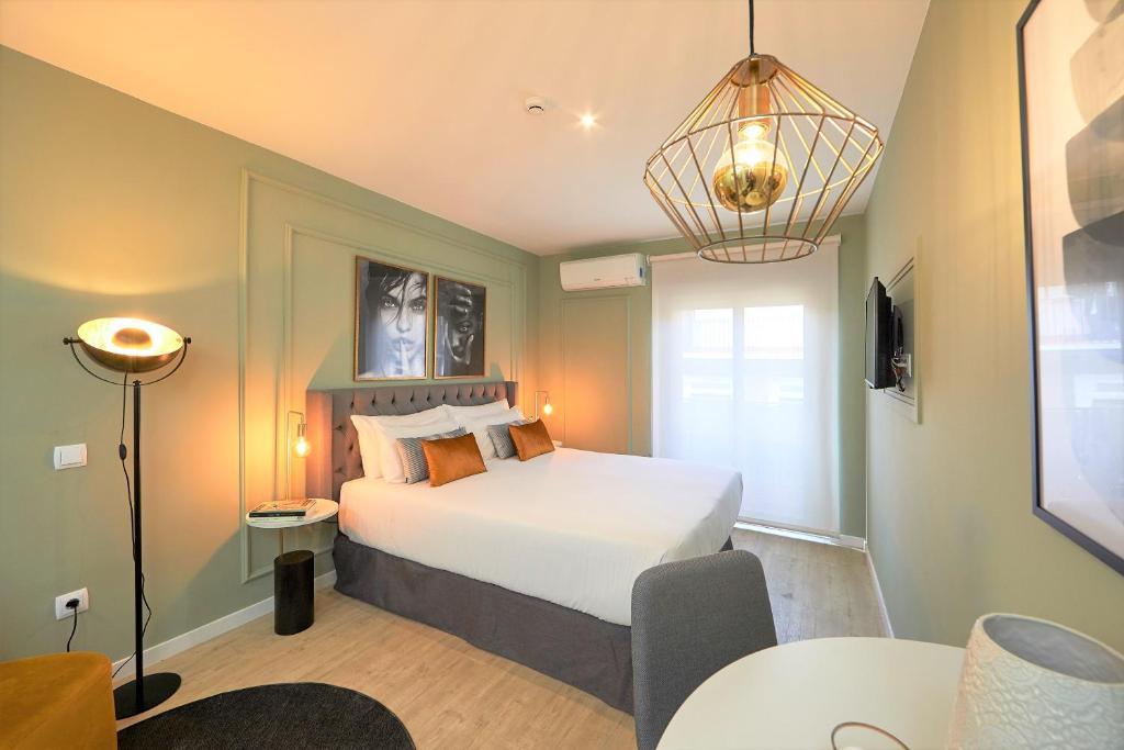 Cama o camas de una habitación en L&H La Latina