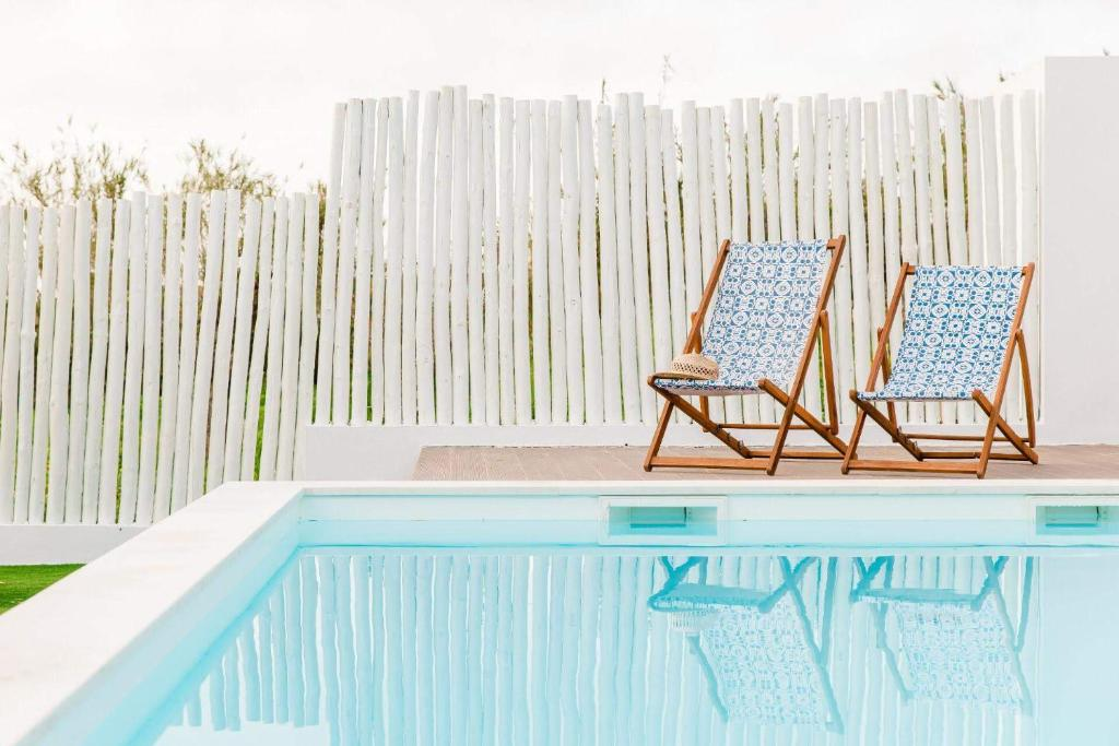 The swimming pool at or near Quinta das Alfazemas