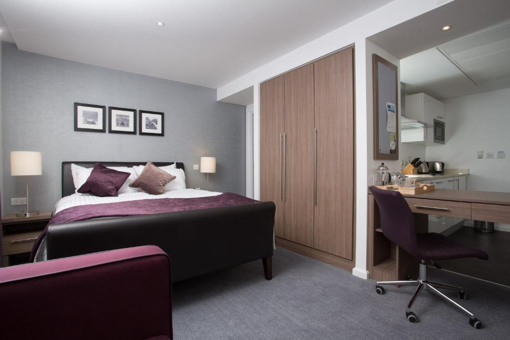 A bed or beds in a room at Staybridge Suites Birmingham, an IHG hotel