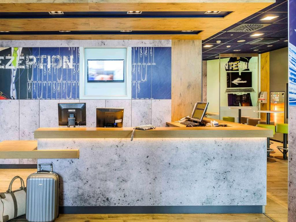 The lobby or reception area at Hotel Ibis Budget Deauville