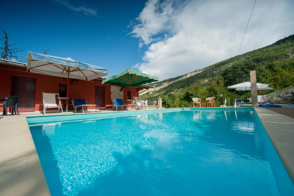 The swimming pool at or near B&B Mosca Bianca
