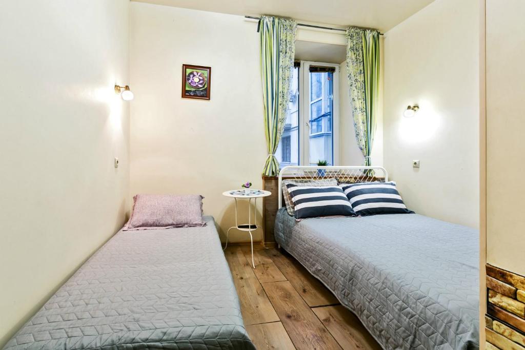 A bed or beds in a room at Sonya on Krasnye Vorota