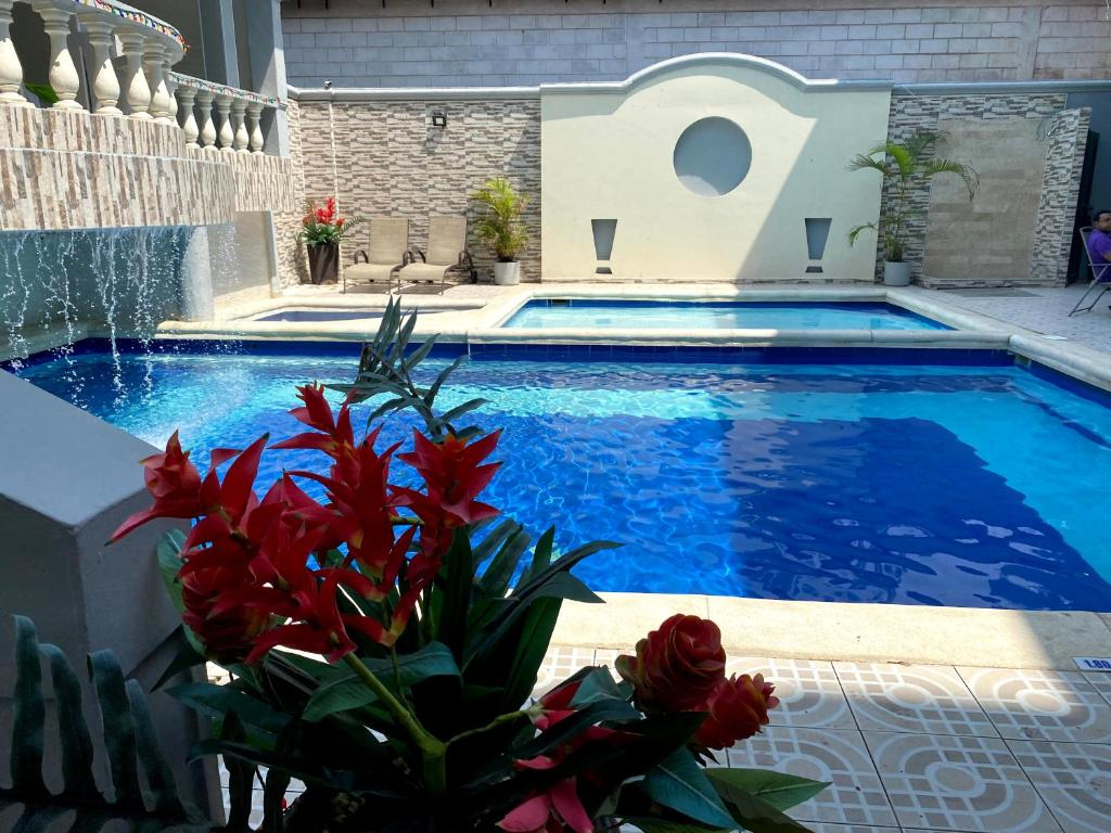 The swimming pool at or near Hotel Puerta de Oro