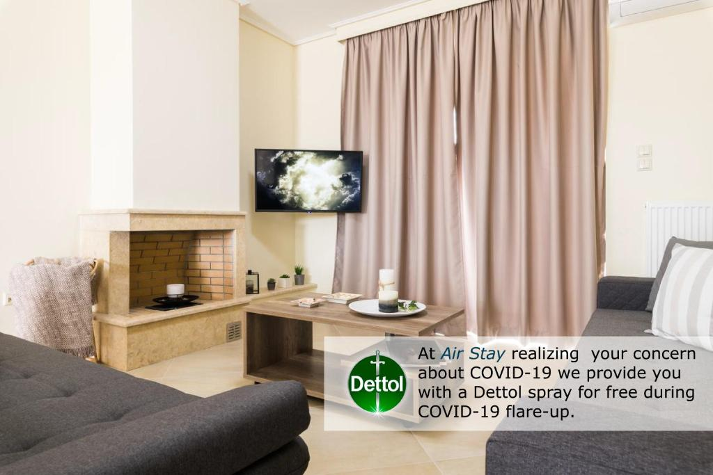 A television and/or entertainment center at Thresh Apartments Airport by Airstay