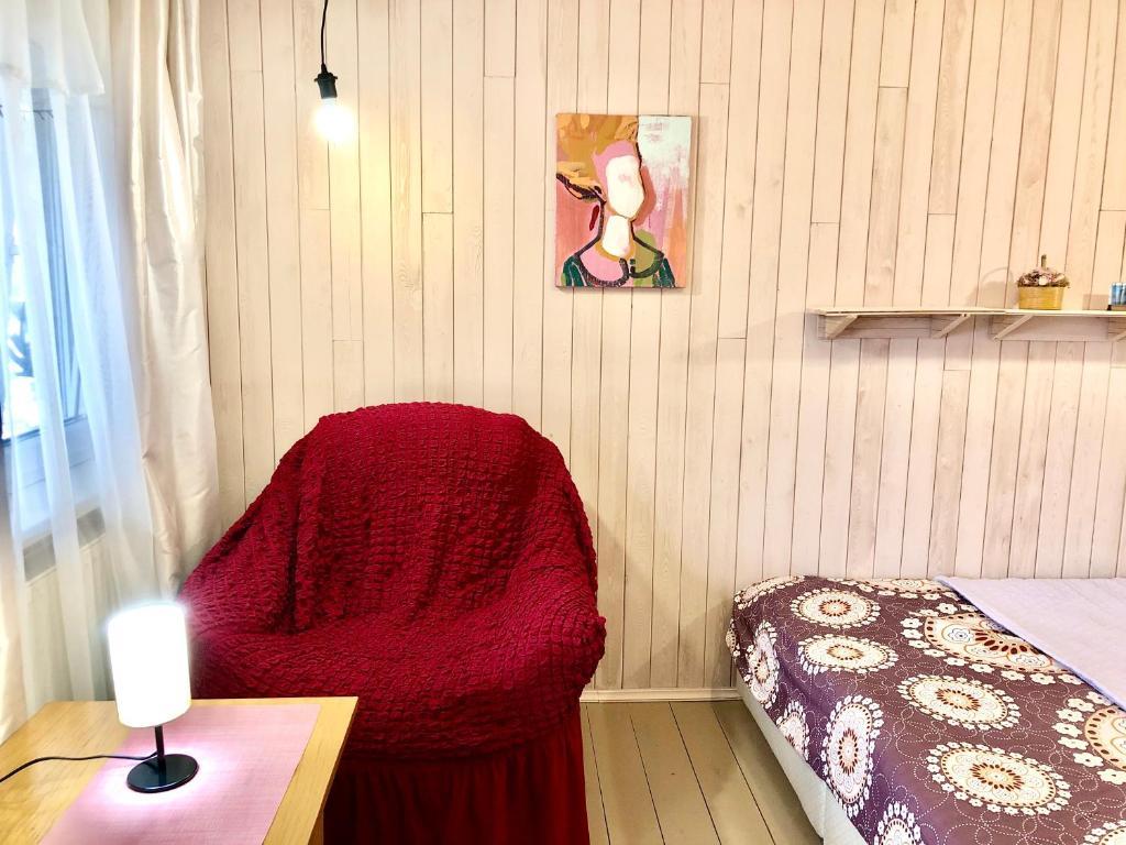 """Кровать или кровати в номере """"Солнечная горка"""""""