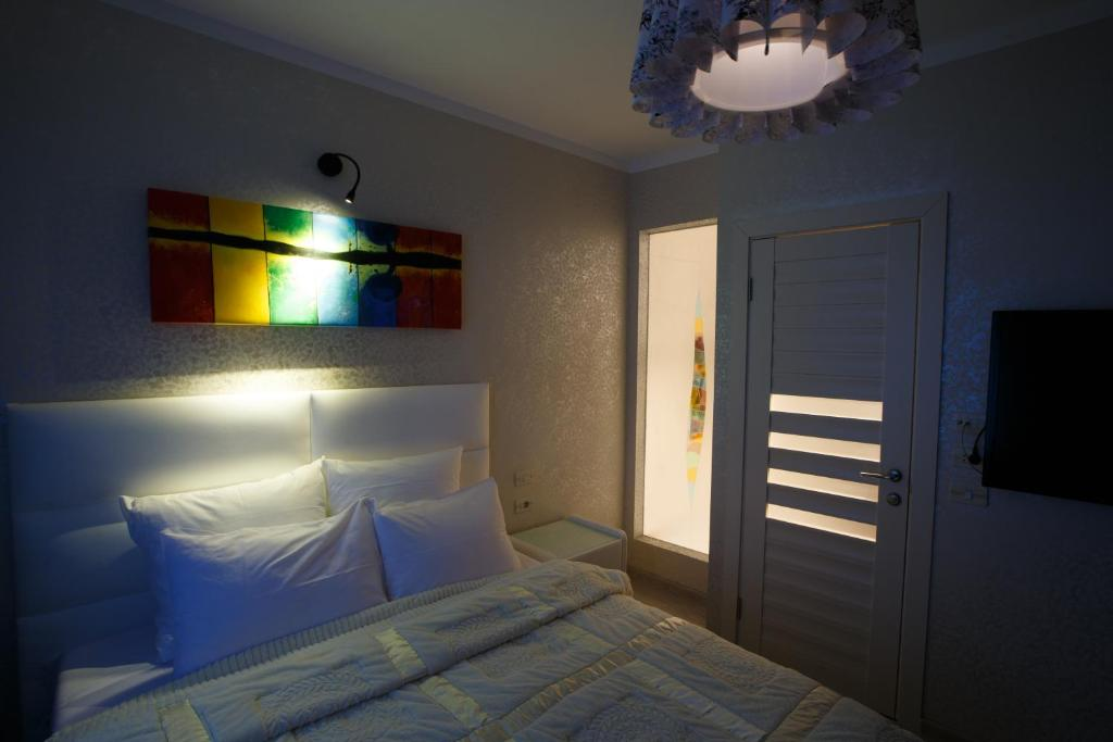 A bed or beds in a room at Шереметьево-Испания