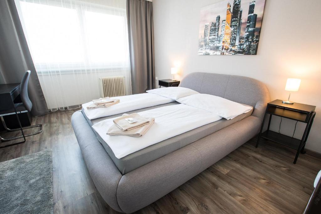Postel nebo postele na pokoji v ubytování A-Sport Hotel