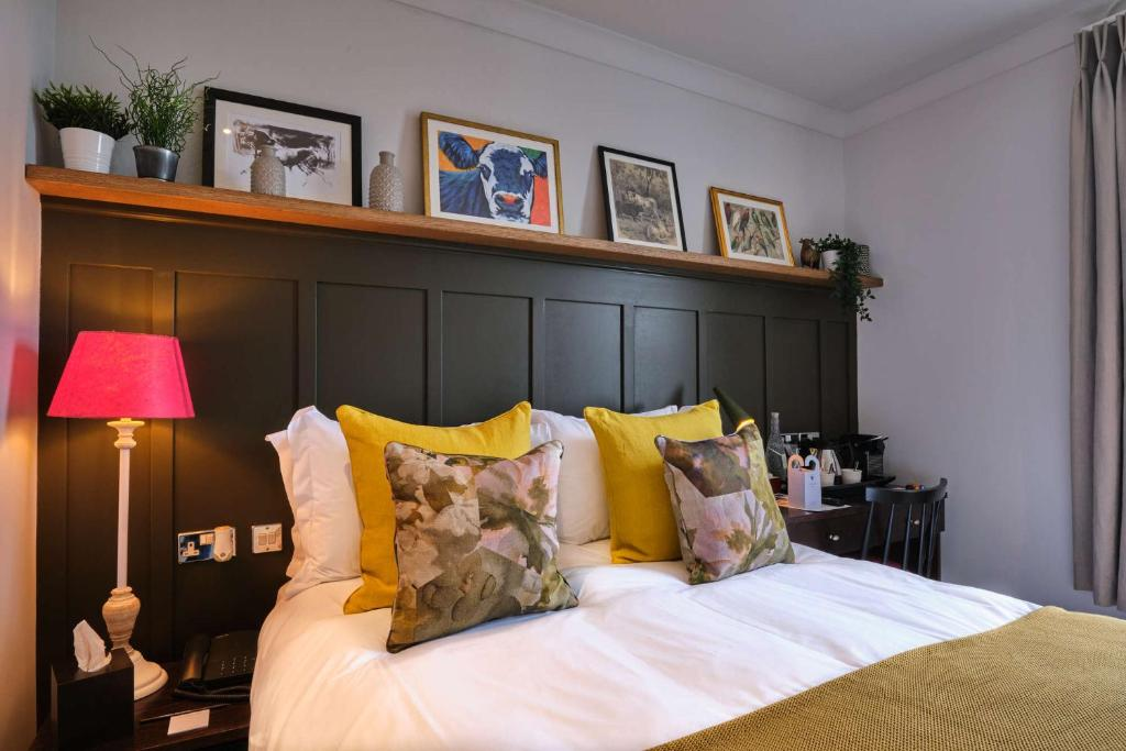 A bed or beds in a room at The Bulls Head Hotel