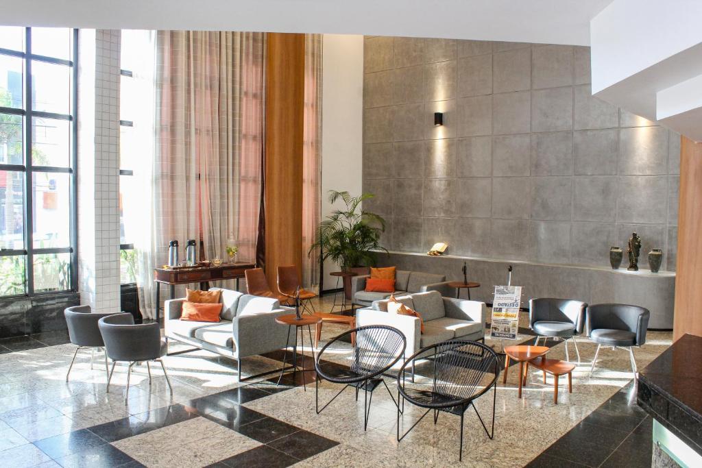 Um restaurante ou outro lugar para comer em Hotel Abbeville Torre I
