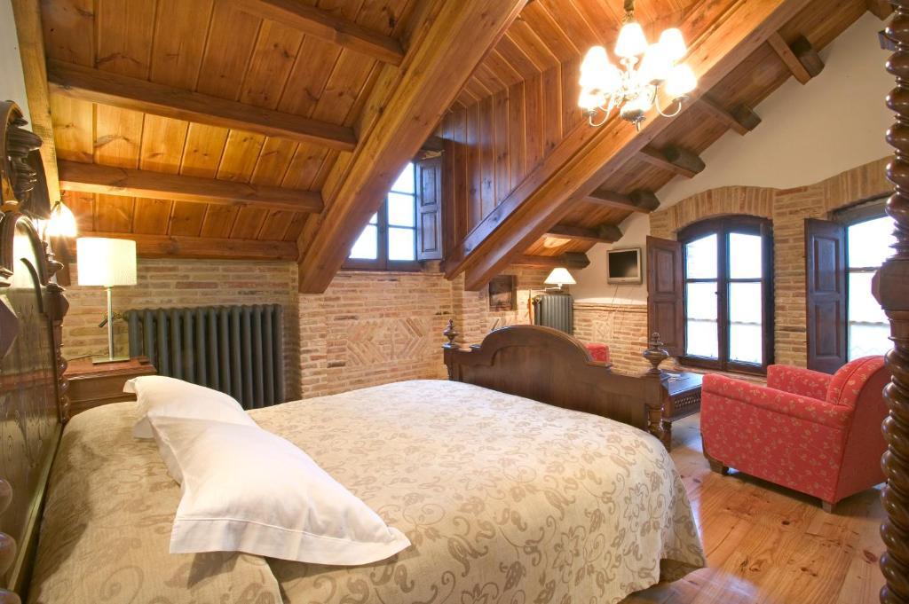 Cama o camas de una habitación en Hostería Camino