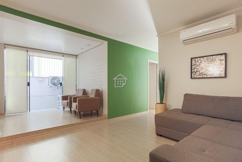 A seating area at O melhor apartamento em frente ao Parcão