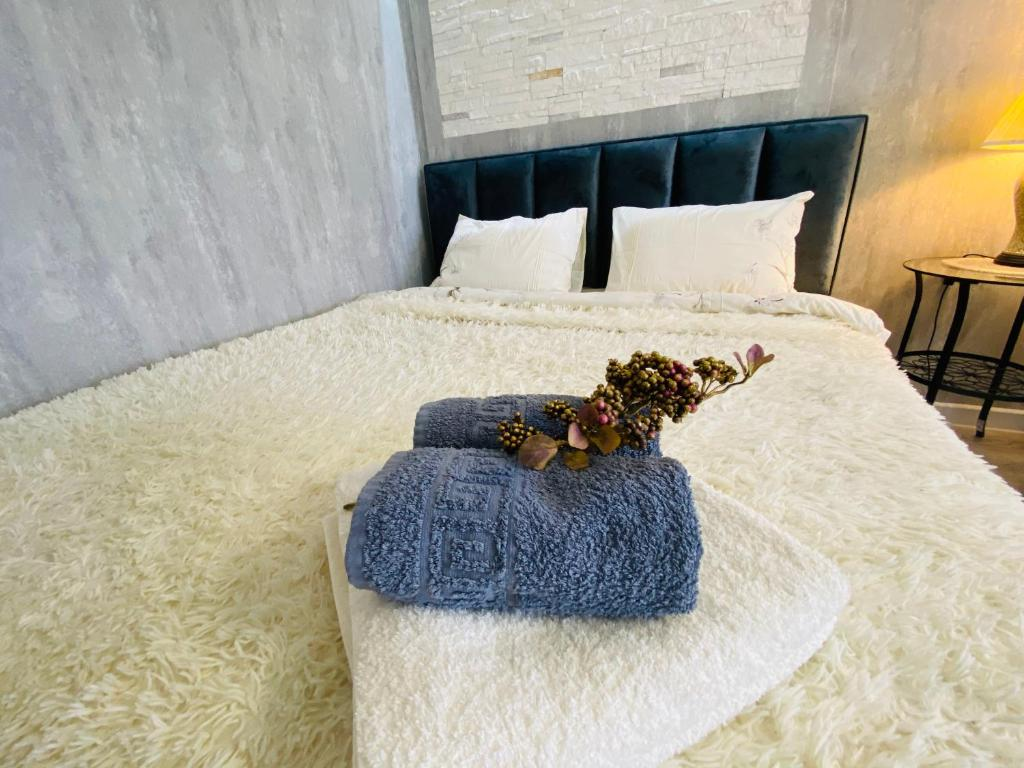A bed or beds in a room at Apartments Mayak