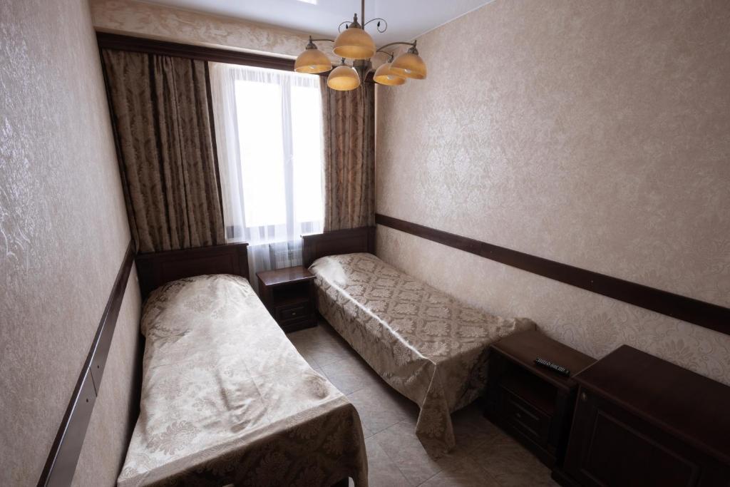 Кровать или кровати в номере Отель НИТРОН