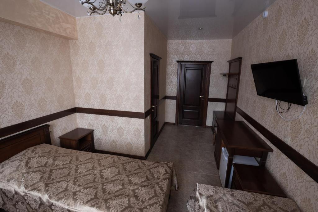 Телевизор и/или развлекательный центр в Отель НИТРОН