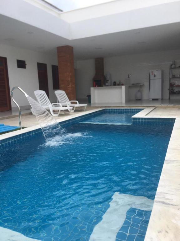 The swimming pool at or close to Casa dos Sonhos 2